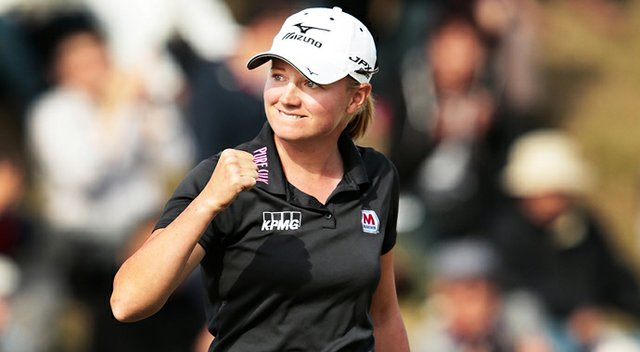 Stacy Lewis celebrates after sinking her birdie put on the 18th and winning the Mizuno Classic at Kintetsu Kashikojima Country Club.