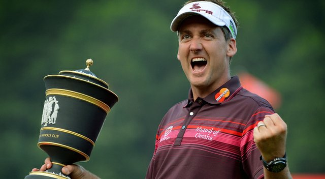Ian Poulter celebrates with the trophy after winning the WGC-HSBC Champions tournament held on the Olazabal Course at the Mission Hill Golf Club.