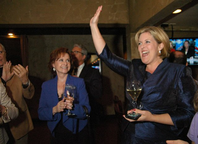 Karen Castor Dentel celebrates her victory on Tuesday night at SoNapa Grille in Maitland.