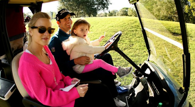PGA Tour player Erik Compton with his daughter, Petra, 3 1/2, and wife Barbara during the PGA Tour Father/Child Tournament on the Oak Trail Course.