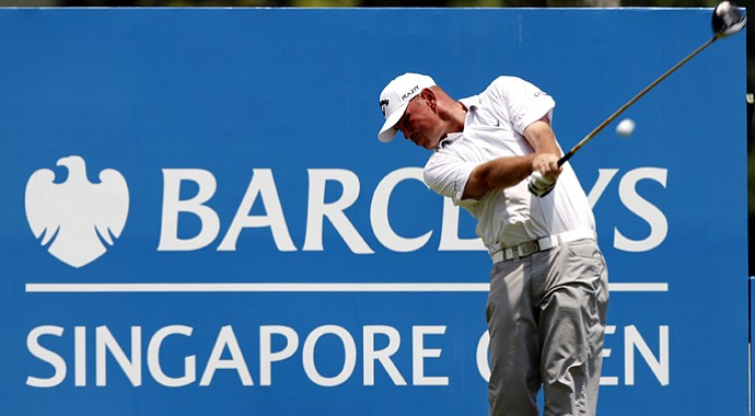 Thomas Bjorn has the early lead after the rain-interrupted first round of the Singapore Open.