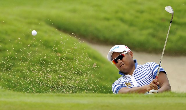 Thailand's Chapchai Nirat hits a sand shot during Day 2 of the Singapore Open.