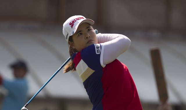 South Korea's Inbee Park watches her shot after she tees off on the first hole during the third day of the LPGA Lorena Ochoa Invitational at the Guadalajara Country Club in Guadalajara, Mexico.