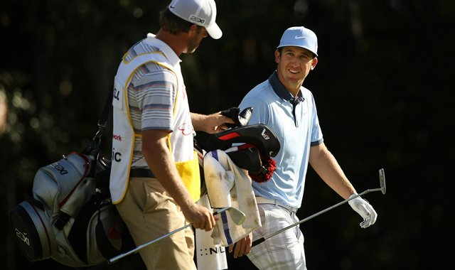 Kevin Chappell walks up No. 18 with his caddie on the Magnolia Course during the final round of the Children&#39;s Miracle Network Hospitals Classic.
