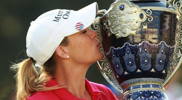 Cristie Kerr kisses the trophy after winning the LPGA Lorena Ochoa Invitational.