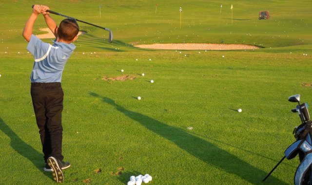 Itai Cohen, 7, swings for the fences at Caesarea Golf Club.