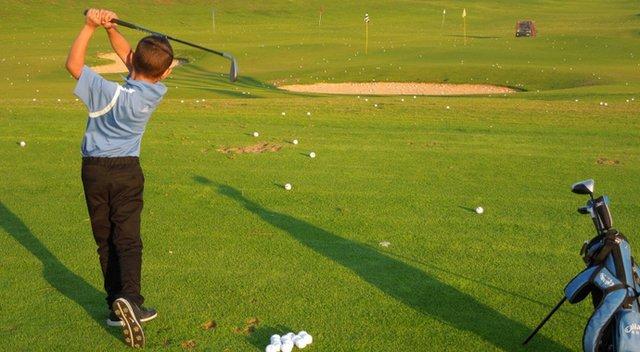 Itai Cohen, 7, swings for the fences at Caesarea Golf Club.