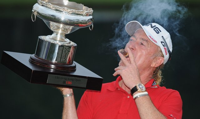 Miguel Angel Jimenez with the winners trophy and his cigar after the final round of the UBS Hong Kong Open.
