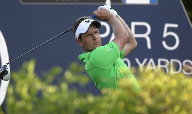 Luke Donald eyes his tee shot on the 18th hole during the first round of DP World Golf Championship in Dubai.