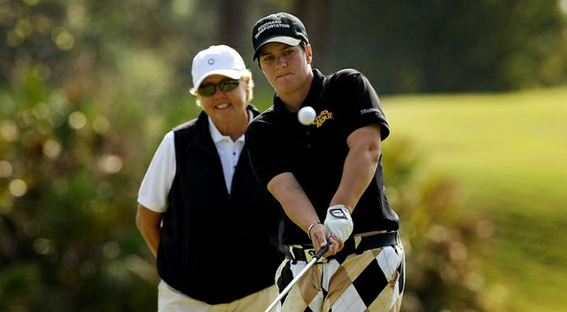 Meaghan Francella gets in a last practice session with swing instructor Gale Peterson at LPGA International before the start of Q-School.