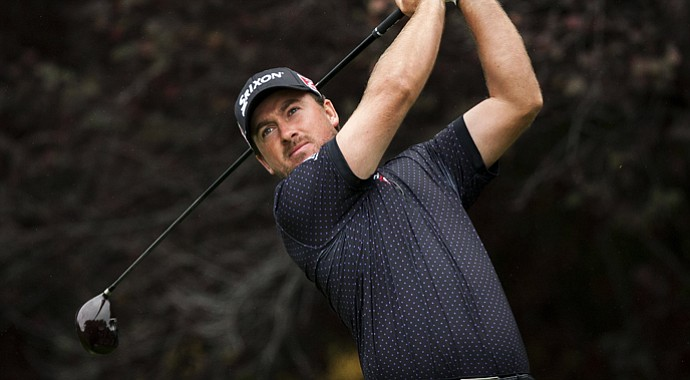 Graeme McDowell tees off on the second hole during the first round of the World Challenge golf tournament at Sherwood Country Club in Thousand Oaks, Calif., Thursday, Nov. 29, 2012.