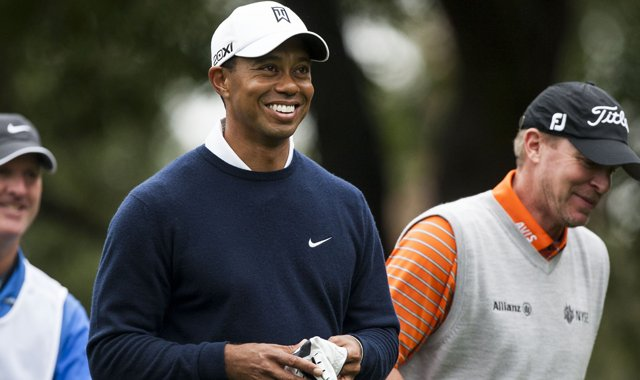 Tiger Woods shares a laugh with Steve Stricker during the first round of the World Challenge in Thousand Oaks, Calif.