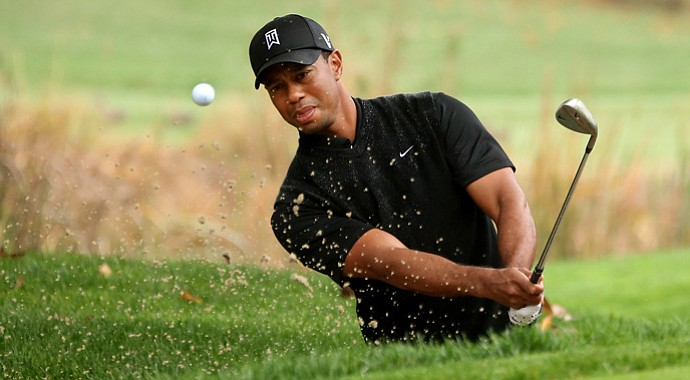 Tiger Woods hits out of a bunker on the fourth hole during the third round of the Tiger Woods World Challenge.