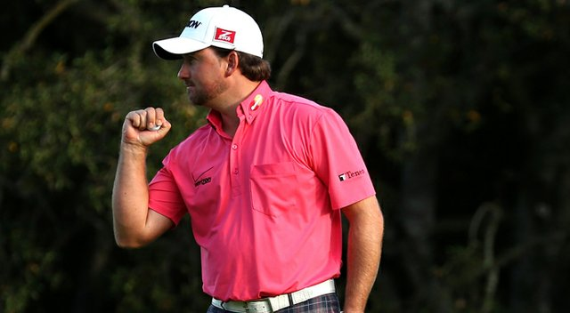 Graeme McDowell pumps his fist after making a birdie putt on the 18th hole to cement a three-stroke victory during the final round of the Tiger Woods World Challenge.