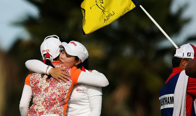 Moriya Jutanugarn of Thailand hugs Japan&#39;s Ayako Uehara after the final round of LPGA Q-School. Both players earned their tour cards. 
