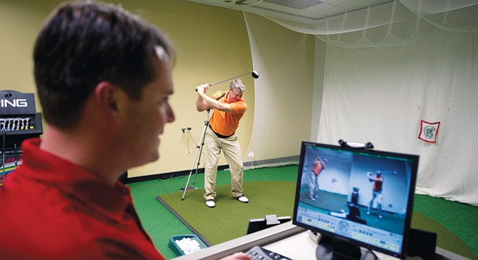 Instructor Andy Hilts works with Doug Hartley at GolfTEC's corporate headquarters in Centennial, Colo., near Denver.