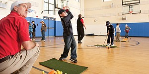 Lewis takes junior golf instruction straight to schools