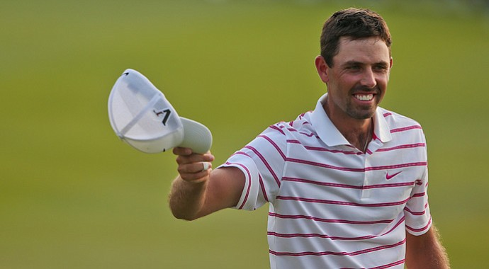 Charl Schwartzel reacts after winning the Thailand Golf Championship 2012 at Amata Spring Country Club.