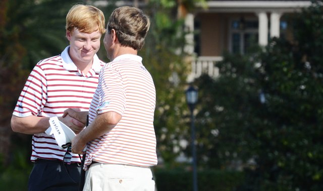 Dru Love (left) shakes hands with his father, Davis Love III, after they carded a 12-under 60 to take the lead at  the Father/Son Challenge at the Ritz-Carlton Golf Club in Orlando.
