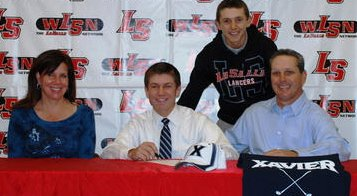 Matthew Wetterich is surrounded by family members as he signs his letter-of-intent to Xavier University.