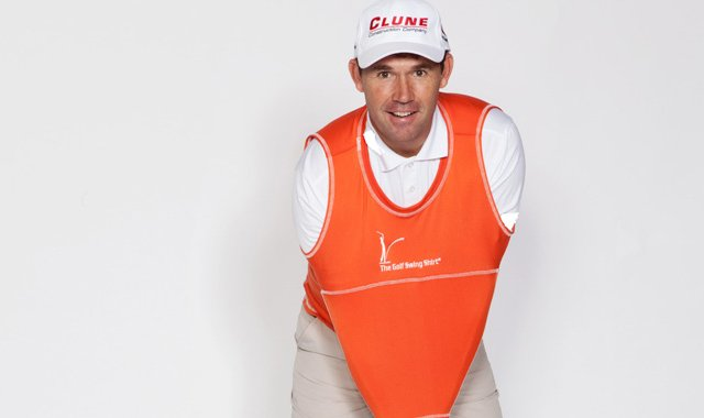 Padraig Harrington shows off the Golf Swing Shirt, a practice device that helps connectivity during a golfer's swing.