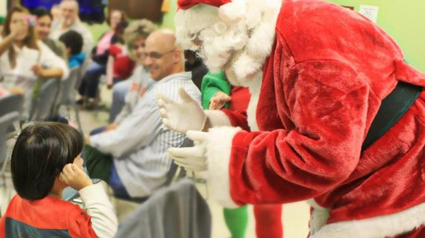 Santa Claus said hello with sign language at a Christmas party for deaf clients Dec. 13.