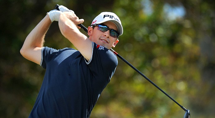Scott Langley hits a drive on the first hole during the third round of the Sony Open.