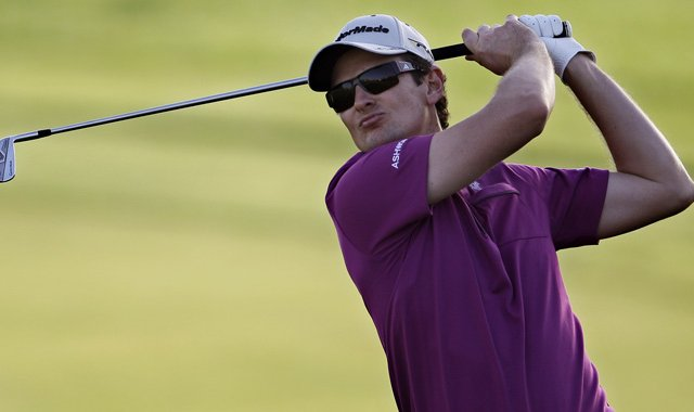 Justin Rose watches a shot during the first round of the Abu Dhabi HSBC Championship.