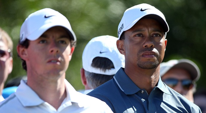 Rory McIlroy (left) and Tiger Woods both struggled with accuracy off the tee and hitting greens in regulation.