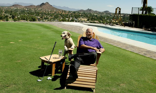 John Solheim with his dog at his home in Phoenix, Ariz.