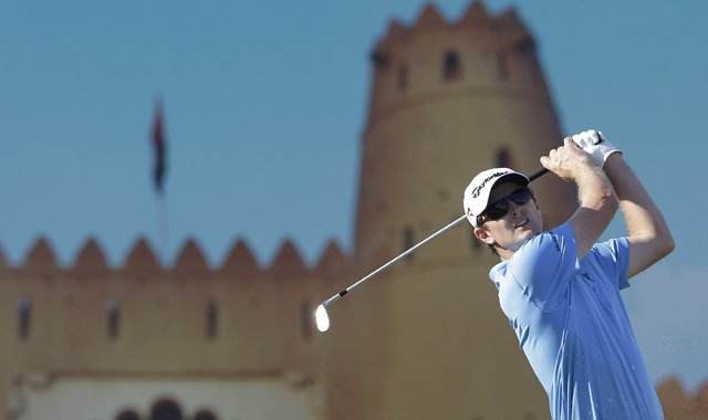 Justin Rose of England follows his ball on the 15th hole during the third round of Abu Dhabi Golf Championship in Abu Dhabi, United Arab Emirates, Saturday, Jan. 19, 2013.