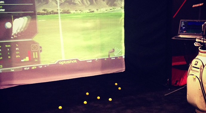 OptiShot, the simulator, comes in the size of a shoe box.