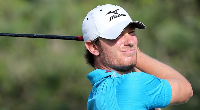 England's Chris Wood plays a shot during the third round of the Qatar Masters.