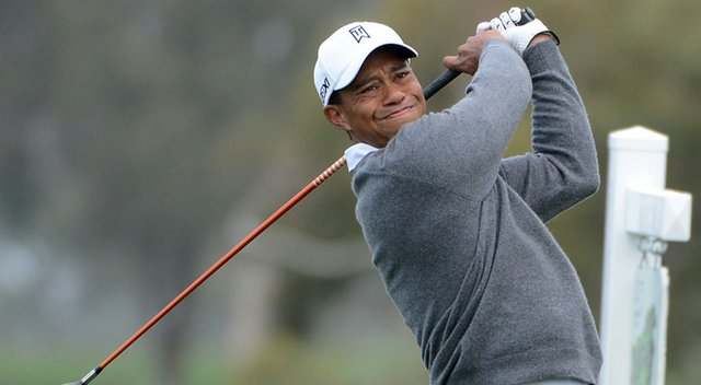 Tiger Woods hits a tee ball during the third round at the Farmers Insurance Open.