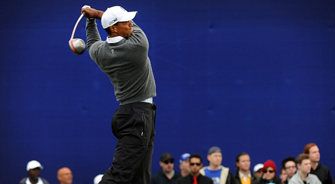 Tiger Woods hits a drive on the seventh hole during the third round of the Farmers Insurance Open.