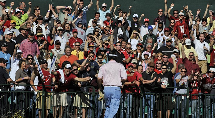 The crowds can be rowdy at the par-3 16th hole at TPC Scottsdale.