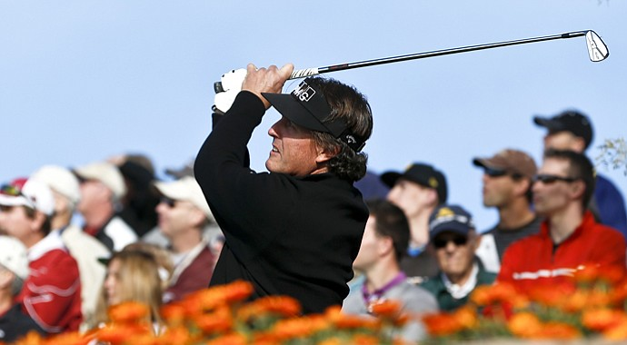 Phil Mickelson tees off on the 12th hole during the first round of the Waste Management Phoenix Open.