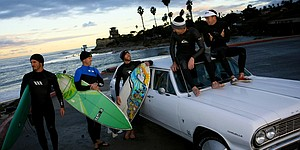 Along the shores of Pacific, golf's brightest unwind on surfboards