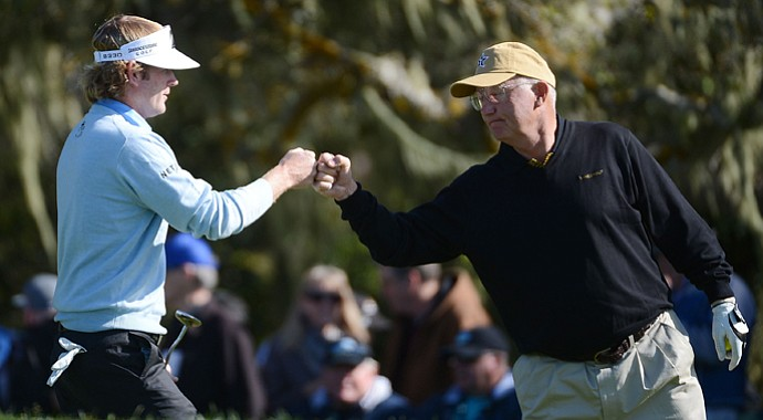 Brandt Snedeker (left) celebrates his eagle on the second hole with his playing partner Toby Wilt during the final round of the AT&T Pebble Beach National Pro-Am at Pebble Beach Golf Links.
