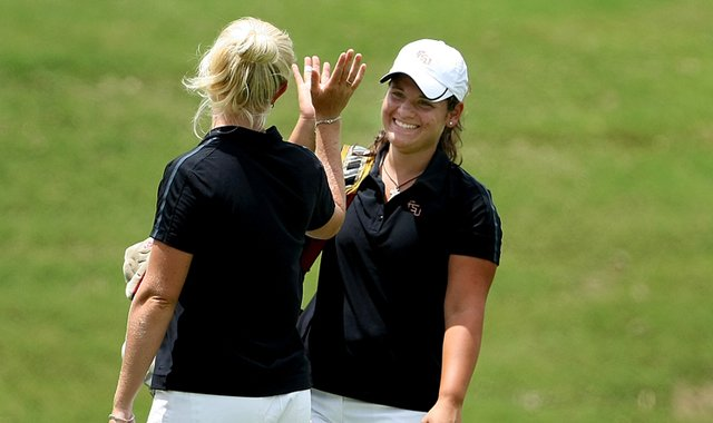 Florida State&#39;s Jessica Negron gets a high-five during the 2011 NCAA East Regional.