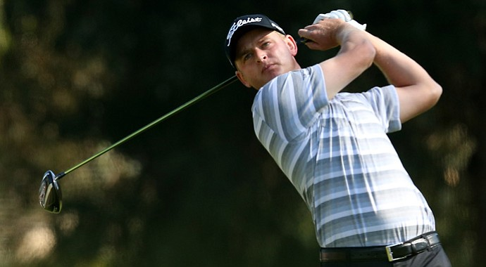 John Merrick hits his tee shot on the second hole during the final round of the Northern Trust Open.