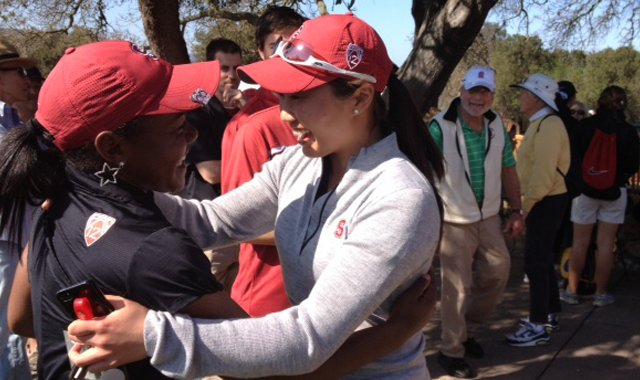 Mariah Stackhouse (left) is congratulated by a teammate after her 10-under 61 at the Peg Barnard Invitational.