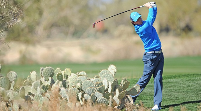 Rory McIlroy plays a shot during practice prior to the start of the WGC-Accenture Match Play Championship.