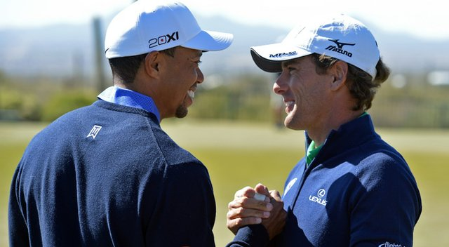 Tiger Woods greets his first-round opponent, Charles Howell III, during a practice round on Tuesday.