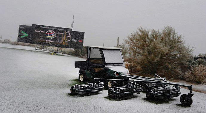 Snow continues to fall on the practice range as snow and rain caused play to be suspended due to weather during the first round of the WGC-Accenture Match Play Championship.