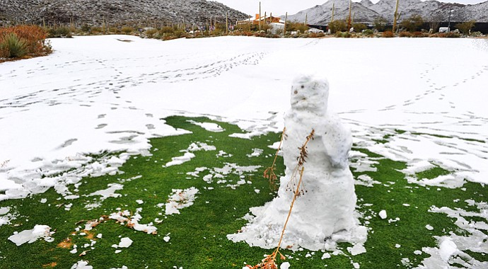 A snowman hitting a golf ball is seen on the course as snow and rain caused play to be suspended due to weather during the first round of the WGC-Accenture Match Play Championship.