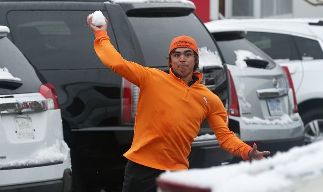 Rickie Fowler throws snowballs at fellow players in the parking lot after a snow storm suspended the Match Play Championship.
