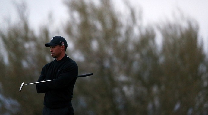 Tiger Woods looks on from the 17th green during the first round of the WGC-Accenture Match Play. Woods would lose his match on the 17th after failing to convert on a 20-footer for birdie.
