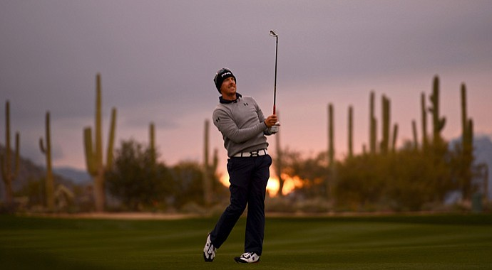 Hunter Mahan hits a shot from the fairway on the first hole during his 4-and-3 victory over Ian Poulter on Sunday morning at Dove Mountain.