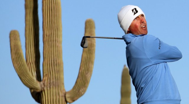 Matt Kuchar hits his tee shot on the sixth hole during the semifinal round of the WGC-Accenture Match Play Championship.
